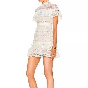 Brand new never worn. Yoke frill mini dress white